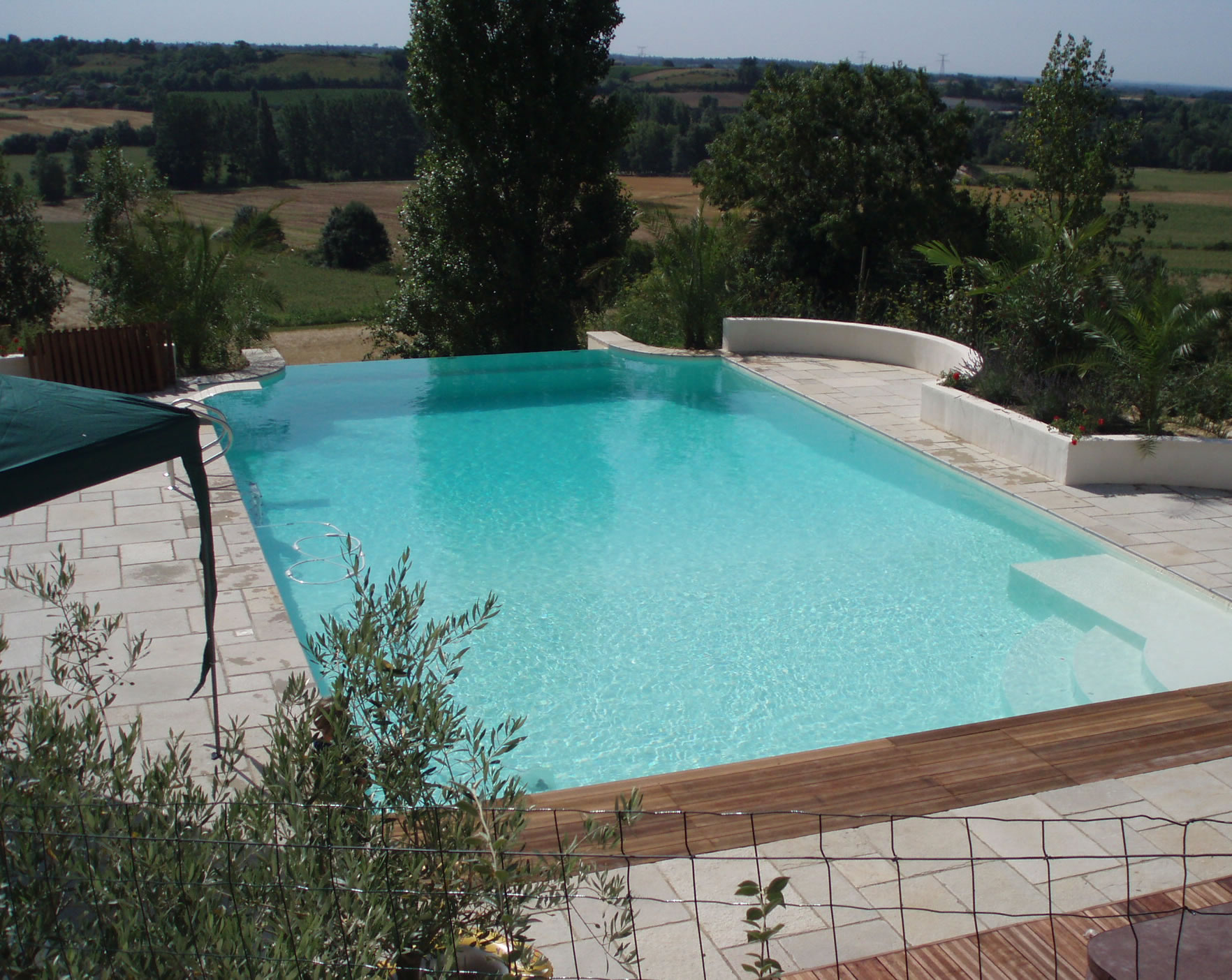 If You Want A New Custom Infinity Edge Swimming Pool Like This At Affordable  Cost .