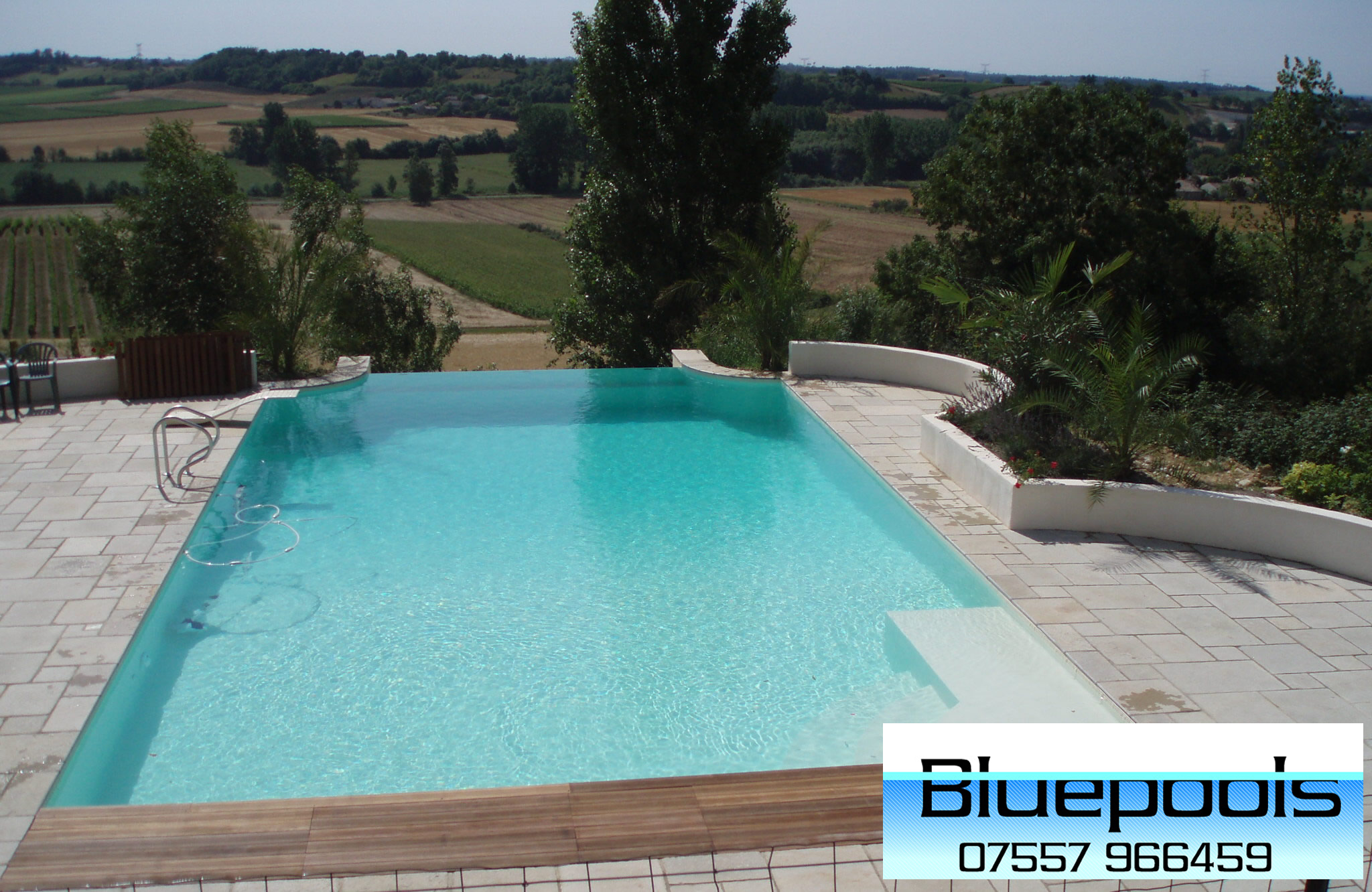 Outdoor pool design for Infinity pool design uk